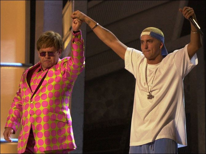 Music-Homophobia In Hip-Hop Elton John, left, and Eminem appear together after performing a duet near the end of the 43rd annual Grammy Awards in 2001 at the Staples Center in Los Angeles. Anti-gay sentiments have been entrenched in hip-hop for decades. Eminem, widely known for offensive lyrics toward homosexuals, has joined Jay-Z in saying people of the same-sex should be able to love one another.
