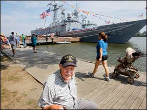Navy veteran Sam Goddess, who served on a PT Boat in the South Pacific during WWII, reacts to seeing the USS De Wert during Navy Week in downtown.