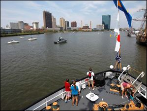 Visitors tour of the deck of the USCGC Mobile Bay during Navy Week.