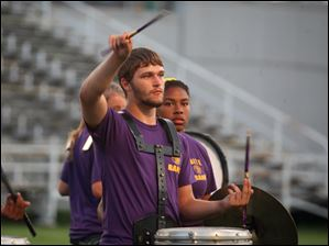 A percussionist with the Waite High School band performs during halftime of the home opener football game against Maumee.
