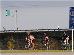 Bikers and runners were the first travelers allowed on the new highway.