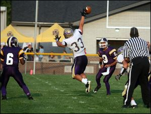 Maumee's Andrew Schultz (33) breaks up a Whitmer pass.