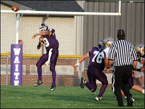 Waite quarterback Johnny Douanglee (9) passes against Maumee.