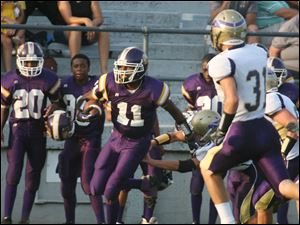 Waite's Charles Smith (11) breaks free to gain yards.