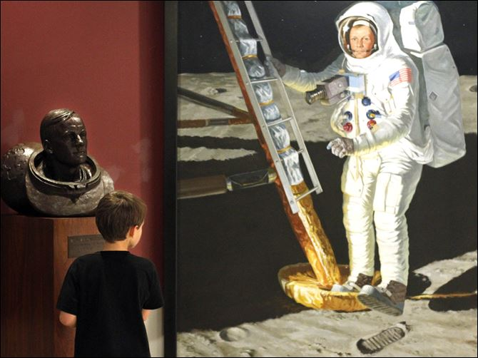 Ezekiel Howie, 9, gazes at a portrait of Neil Armstrong  Ezekiel Howie, 9, gazes at a portrait of Neil Armstrong during a visit to the Armstrong Air & Space Museum in Wapakoneta, Ohio. Ezekiel was on a field trip Tuesday with his mother and brother.