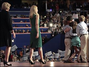Paul Ryan embraces his children Charlie, Liza and Sam, as his mother Betty, left, and wife Janna join him on stage.