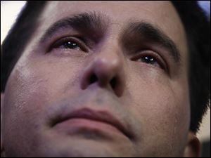 Wisconsin Gov. Scott Walker cries as during Paul Ryan's speech.