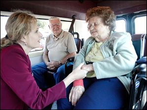 Congressional candidate Ms. Zimmann, left, gets on the Vancrest of Convoy nursing home bus to say hello to 105-year-old resident Gladys Barkley, right, and her son Harold Barkley, left.