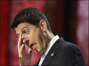 Paul Ryan wipes his tears as he addresses the Republican National Convention.