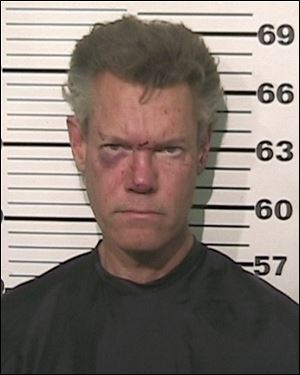 This photo provided by the Grayson County, Texas, Sheriff's Office shows Country singer Randy Travis was charged with driving while intoxicated. Travis was released on $21,500 bond Aug. 8.