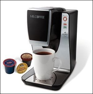 A Mr. Coffee sing-serving brewing machine.