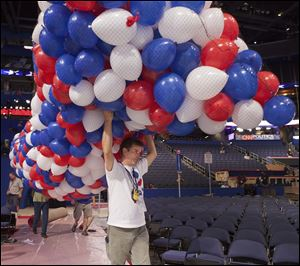 Balloons are carried across the convention floor as preparations continue for the Republican National Convention in Tampa last week.