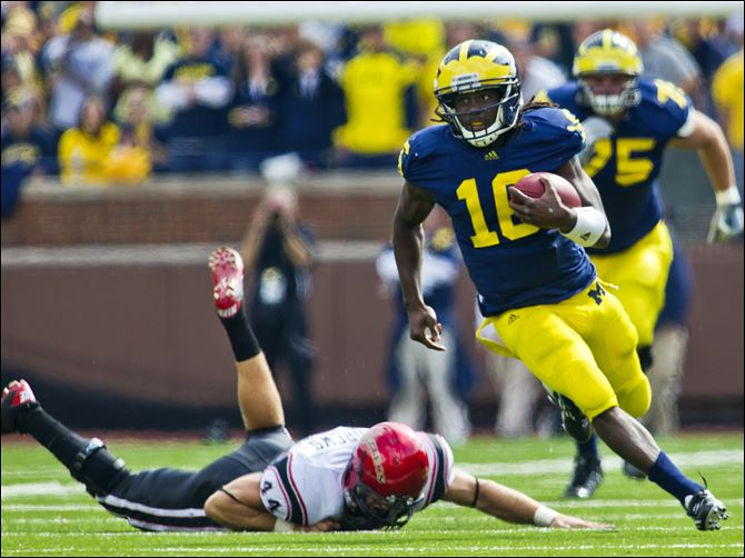 Michigan Denard Robinson  Denard Robinson is second all-time among Big Ten quarterbacks in career rushing yards. Teammates recently paid tribute to his overall character when they picked him to be a team captain.