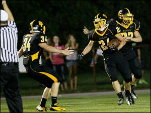 Sylvania's Preston McCurdy, center, celebrates a touchdown against Waite.