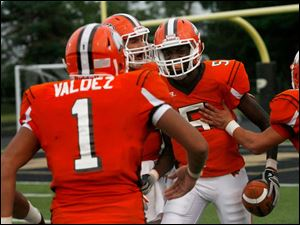 Southview wide receiver J.J. Pickney, center, is congratulated by teammates after his touchdown against Muskegon Heights.