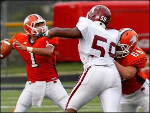 Sylvania Southview's defensive lineman Tim Schlachter, right, blocks for quarterback Austin Valdez during the first quarter.