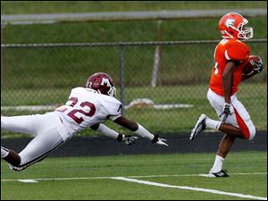 Muskegon Heights' defensive back Derek Pickens can't catch Sylvania wide receiver Malcolm Johnson who ran the ball in for a touchdown.