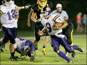 Waite quarterback Johnny Douanglee rushes for a gain during the fourth quarter.