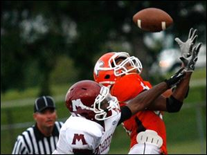 Muskegon Heights' John King can't stop Southview wide receiver Nate Hall from completing the reception for a touchdown.