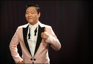 South Korean rapper PSY, born Jae-Sang Park, posing for a photo in New York.