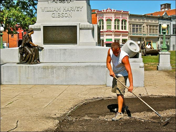 Seneca Co. Dan Koerper Dan Koerper of Mohawk Nursery prepares topsoil near the statue of Gen. William Harvey Gibson. He was part of a four-men crew who worked Thursday. Underground irrigation is to be completed today.