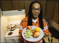 vegetarian Ishmael Shakur Ishmael Shakur holds a plate of fruit at his home in Toledo.