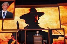 Actor-Clint-Eastwood-with-a-photo-projected-behind-him
