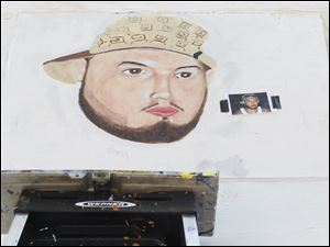 A portrait of the nephew of OLA artist Leandra Leroux is being painted by Jose Martinez.