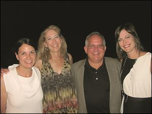 Susan Allan Block, from left, Sandra Hylant, Steve Brown, and Callie Jacoby at the feast.