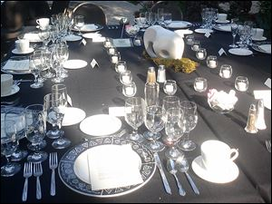 Tables were set with black lines, candles, and animal sculptures.