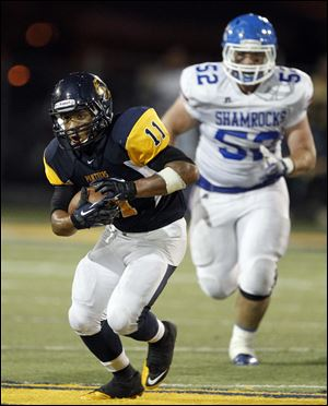 Whitmer's Me'Gail Frisch racks up some yardage. He ran for 109 yards.
