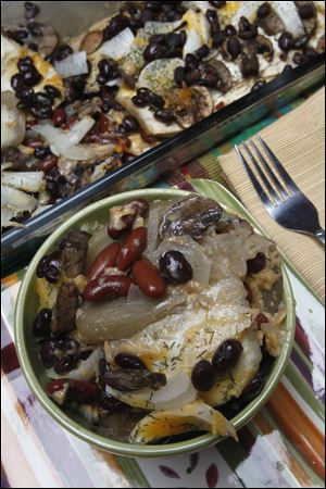 Baked mushroom and eggplant with beans and onions.