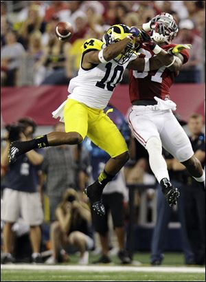 Alabama defensive back Robert Lester breaks up a pass intended for Michigan wide receiver Jeremy Gallon.
