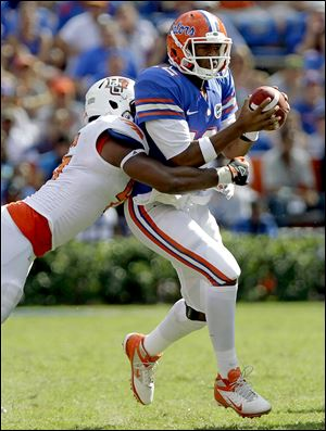 Florida quarterback Jacoby Brissett is tackled by BG defensive lineman Charlie Walker.