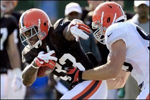 Coming off a dismal 4-12 season, their eighth in nine years of at least 10 losses, rookie running back Trent Richardson, left, and the Browns enter 2012 with high hopes and low expectations. The Browns open the season Sunday at home against the Philadelphia Eagles.