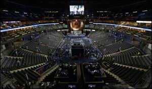 The production crew works on final adjustments for the Democratic National Convention in Time Warner Cable Arena in Charlotte. The convention starts Tuesday.