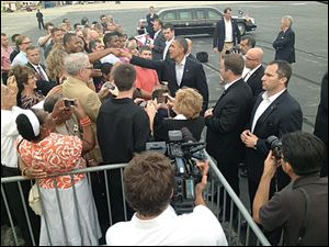 President Obama greets people Sunday night at Toledo Express Airport. The wheels touched down at 7:12 p.m.