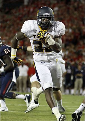 Toledo's David Fluellen runs into the end zone against Arizona on Saturday night in Tucson, Ariz. The Wildcats had a 624-358 advantage in total yards.