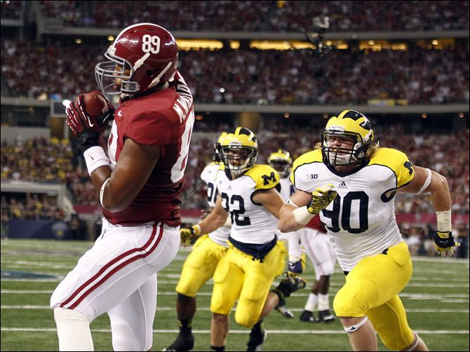 Alabama Michigan follow Alabama tight end Michael Williams, left, pulls in a touchdown pass in front of Michigan linebacker Jake Ryan (90) and safety Jordan Kovacs during the first half Saturday night at Cowboys Stadium in Arlington, Texas. Michigan lost 41-14.