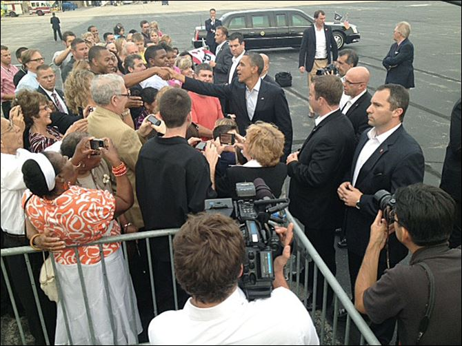 obamaarrives.jpg President Obama greets people Sunday night at Toledo Express Airport. The wheels touched down at 7:12 p.m.