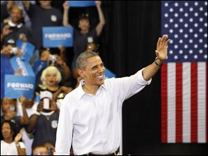 President Barack Obama waves good bye.
