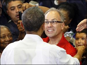 Steve Hall, a Chrysler employee and a member of UAW Local 12, greets the president.