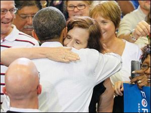President Obama hugs a supporter in the Toledo school gymnasium.