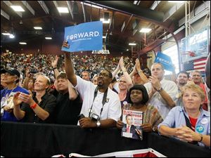 Joe Curry, of Toledo, center, joins supporters cheering Mr. Obama.