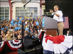 President Obama campaigns at Scott High School.