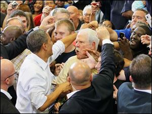 President Obama shakes hands with supporters after his speech.