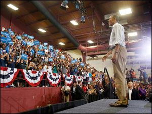 President Barack Obama is cheered by local supporters after his speech.