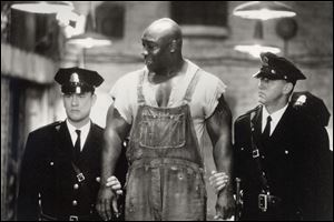 "Tom Hanks, left, Michael Clarke Duncan, center, and David Morse in ""The Green Mile."""