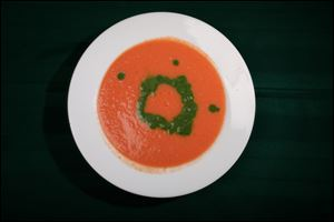 Tomato soup with spinach coulis.