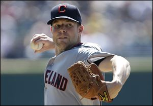 Cleveland Indians starting pitcher Corey Kluber throws against the Detroit Tigers in the first inning of a baseball game in Detroit.